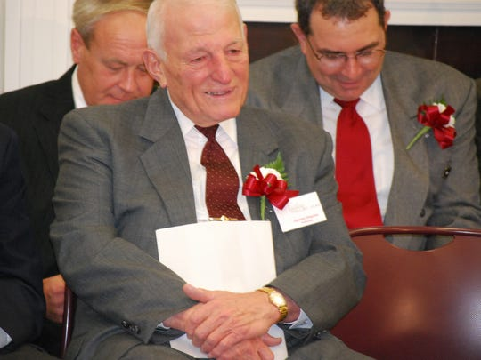 Honoree Carmen Orechio, foreground, joins Robert Jernick, on behalf of his father William Jernick; and Harry Hopkins, on behalf of his father Victor Hopkins; during the 2009 Nutley Hall of Fame induction ceremony.