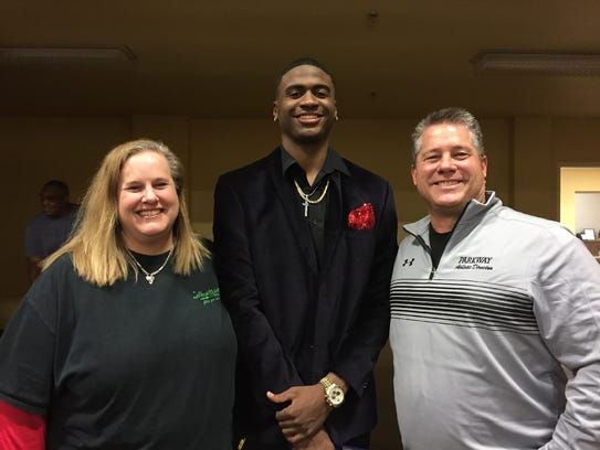 Susan and Rick Bryant flank TCU signee Justin Rogers