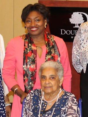State Sen. Andrea Stewart-Cousins (standing) with Lois Bronz