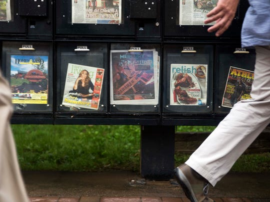 People walk past a Knoxville Mercury box on Gay Street Wednesday, July 5, 2017. The Knoxville Mercury will publish its last issue July 20, according to an editor's note posted on the publication's website.