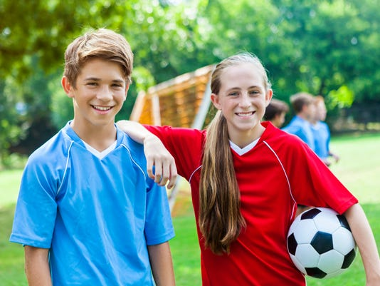 Soccer buddies during soccer practice