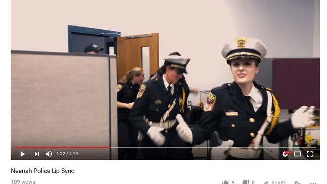 """Neenah police lip sync to the song """"Footloose"""" as part of the national law enforcement lip sync challenge."""