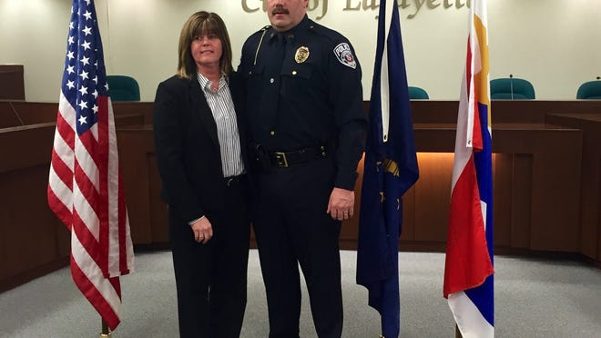 Lafayette police Sgt. B.T. Brown poses for a photo with his wife, Angie Brown, Friday, March 27, after a pinning ceremony acknowledging his rank promotion.