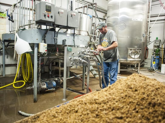 Dave Eggert, assistant brewer, works in the brewhouse