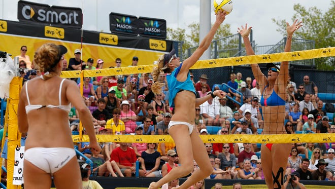 Kerri Walsh Jennings puts the ball over the net against Lauren Fendrick during their championship match in the AVP Cincinnati Open in Mason in August of 2014.