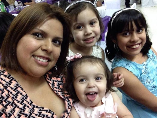 This is a  Facebook photo of Maria Navas and  her three daughters.  All four were victims of a fatal shooting Sunday morning in San Carlos Park.1