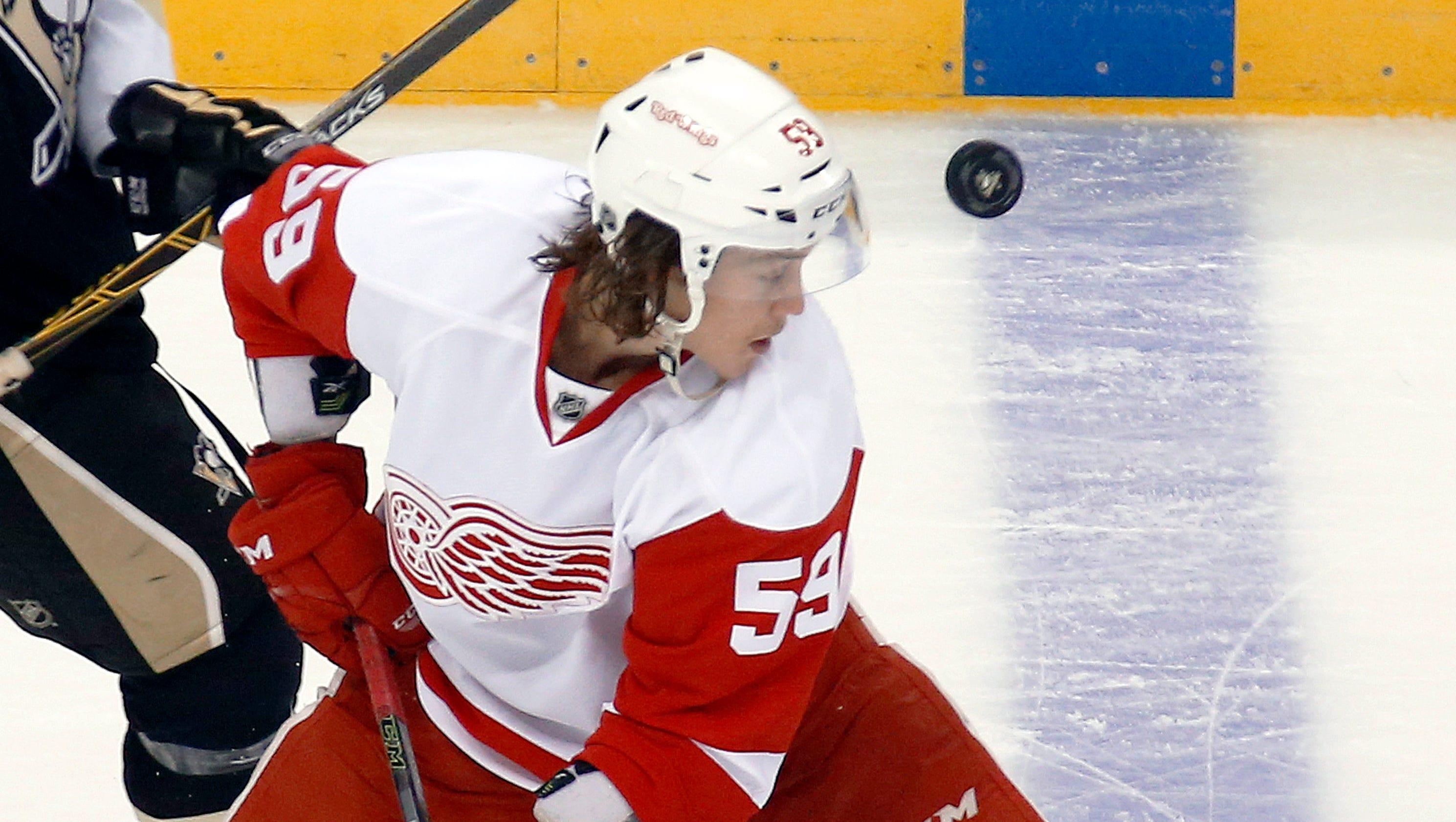 635970252622968261-ap-red-wings-penguins-hockey