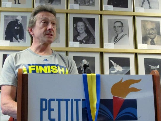 Richard Dodd speaks to the Badgerland Striders in 2016 with his Boston Marathon medal hanging over the lectern. The longtime distance runner, who has battled alcohol addiction and is now 10 years sober, is organizing a run in memory of his former pupil at Whitnall High School, Ethan Monson-Dupuis, who died of a heroin overdose in 2016.