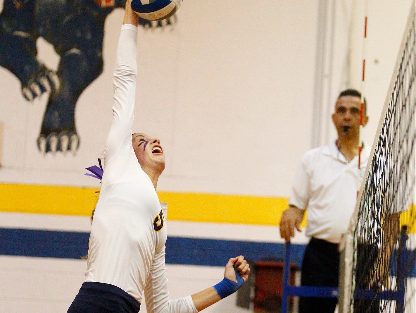 Panas' Yvette Burcescu (5) slams a kill shot during the 11th Annual Panther Invitational Volleyball Tournament at Walter Panas High School in Cortlandt Manor on Saturday, September 27, 2014.