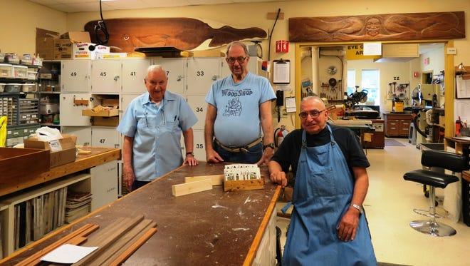 Seabrook woodshop members Felix Lavicka, Jack Cunningham, and Bill Bocchino