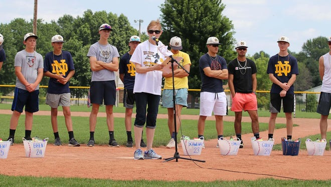 Mary Jo Miller talks about the Notre Dame High School baseball team during a send-off to the state tournament Friday at Winegard Field. The team plays Saturday at 1:30 p.m. against Remsen-St. Mary's at Principal Park in Des Moines.