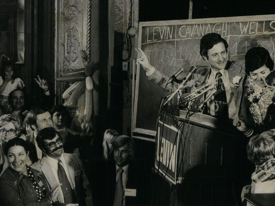 Sander Levin and his family acknowledge the cheers of supporters after his victory statement in 1974 at his headquarters in Detroit's Shelby Hotel.
