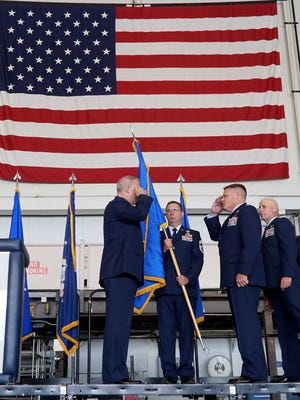 New Commander of the 179th Airlift Wing, Colonel James R. Camp, salutes Major General Stephen E. Markovich (far left) on in this News Journal file photo during the change of command ceremony at the base. Outgoing 179th Airlift Wing Commander, Gary A. McCue (far right) watches as the transition is official.