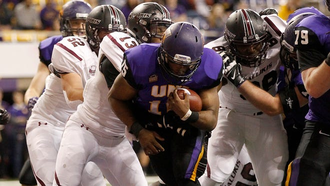Northern Iowa quarterback Aaron Bailey crosses the goal line for his 15th touchdown of the season against Southern Illinois during first half Saturday.