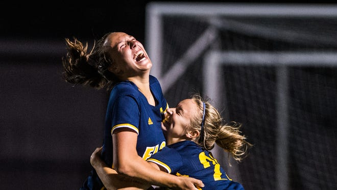 Elco's Ryelle Shuey and Elco's Jordan Rosengrant celebrate's Shuey's game winning goal as Elco beat Cedar Crest 2-1 in double overtime in the annual Blue-Gray Cup on Saturday night.