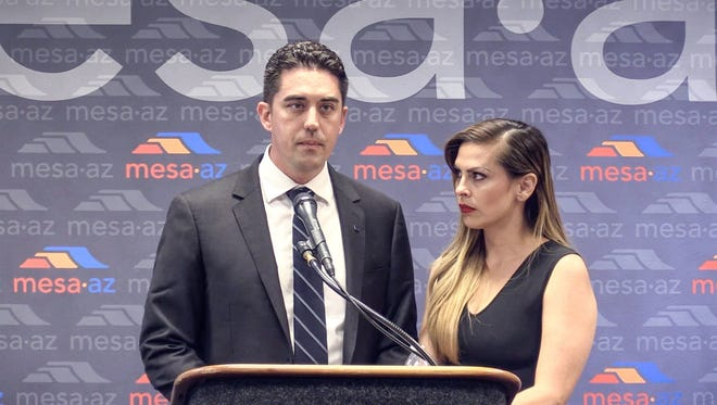 Mesa Councilman Ryan Winkle holds a press conference May 17, 2017, with his wife, Ericka Varela, to address his arrest on suspicion of driving under the influence on May 7. Winkle pleaded guilty to one count of extreme DUI on July 20.