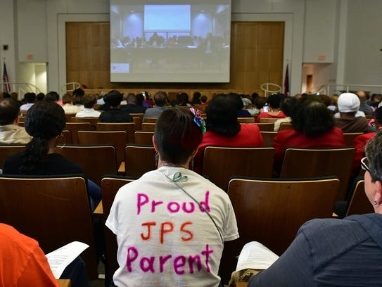 """In this September file photo, community and family members watch as the Commission on School Accreditation holds a hearing regarding the Jackson Public School District's failure to meet accreditation standards and the possible future of the district. How much progress has the state's second largest school district made in fixing accreditation problems that the state board of education declared has been denying students """"the opportunity to learn, to excel and to obtain a free and appropriate education?"""""""
