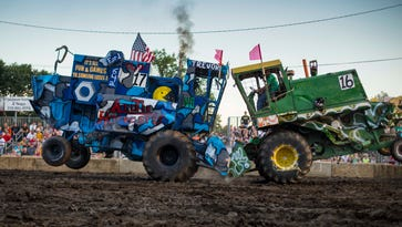 Trevor Eggena of Cedar Falls, left, clashes with Mark Jirak of Shell Rock during the 12th annual combine demolition derby at the Bremer County Fair in Waverly, Iowa, Wednesday July 27, 2016. Combines retired from harvesting are used like their automotive counter parts to bash each other into submission with the last two machines still moving in each heat moving on to a final round. According to event supervisor Derek Sommerfelt it is the most popular attraction at the fair, with over 3,000 watching in the stands.