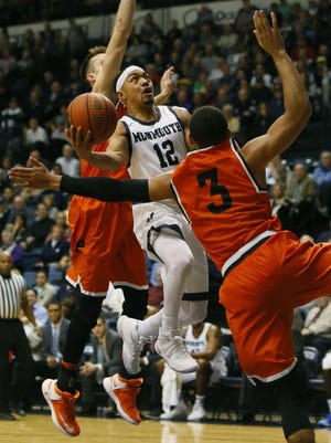 Monmouth Hawks guard Justin Robinson (12) drives to the basket against Princeton Tigers guard Devin Cannady (3) during second half at Ocean First Bank Center. West Long Branch,NJ. Tuesday, December 20, 2016. Noah K. Murray-Correspondent/Asbury Park Press ASB 1221 Monmouth Basketball