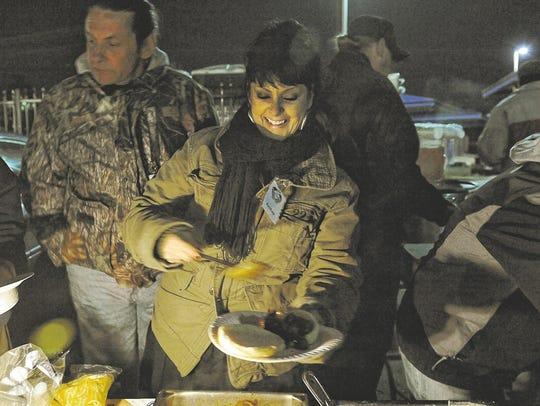 Amber Lynn Dobson serves food for the homeless in November