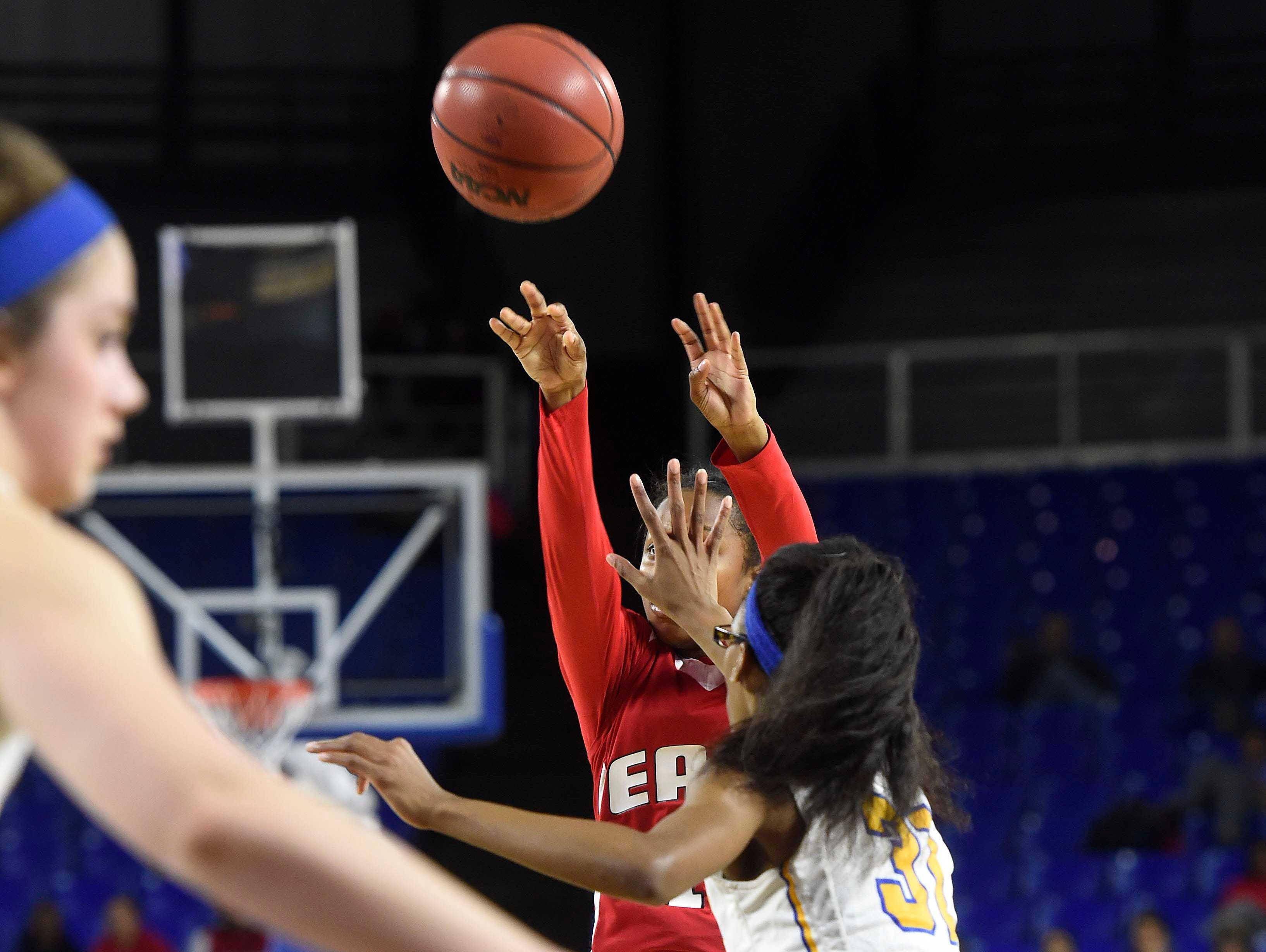 East's Le'Jzae Davidson (10) shoots for two with a hand in her face from Westview's Alexis Beam (32) as Westview High School leads 17-13 East Nashville at the half in the Division I Class AA Girl's basketball semi-finals at the Murphy Center on MTSU's campus March 11, 2016 in Murfreesboro, Tenn.