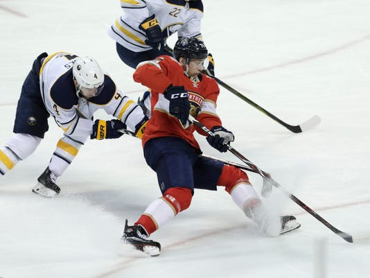 Buffalo Sabres' Josh Gorges (4) and Florida Panthers' Maxim Mamin (78) go for the puck during the second period of an NHL hockey game, Saturday, April 7, 2018, in Sunrise, Fla. (AP Photo/Lynne Sladky)