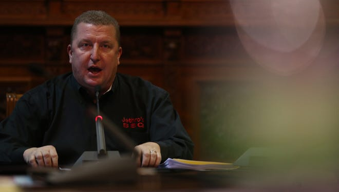 Mike Holms, manager of Jethro's BBQ  speaks in support of House File 295, which would require counties and cities to follow federal or state requirements for minimum wage, during a public hearing on the bill, Monday, Mon. 6, 2017, at the Iowa Capitol, in Des Moines.