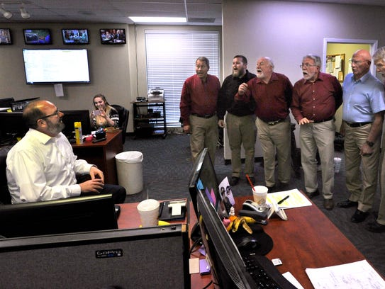 The Memory Men sing a farewell to KTXS television anchor George Levesque Thursday on his last day at the station.