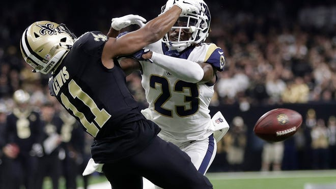 "FILE - In this Jan. 20, 2019, file photo, Los Angeles Rams' Nickell Robey-Coleman breaks up a pass intended for New Orleans Saints' Tommylee Lewis during the second half of the NFL football NFC championship game in New Orleans. Robey-Coleman says he received ""one or two"" death threats from frustrated New Orleans Saints fans on social media after the NFC championship game.  (AP Photo/Gerald Herbert, File)"