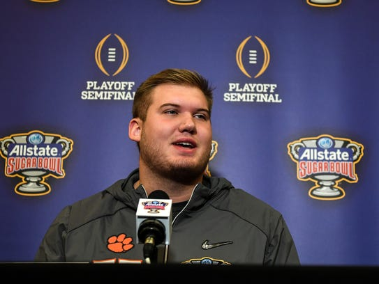 Clemson tackle Mitch Hyatt talks with media during