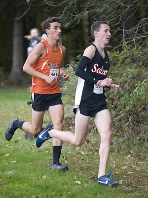 Marlington's Noah Graham (left), shown here at last year's Eastern Buckeye Conference Cross Country Championships, won the large school division race and led the Dukes to the team title at Saturday's Sandy Valley Invitational.