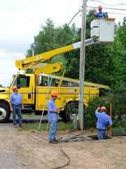 Workers from a Solarus construction crew put in new fiber-optic cable, replacing old copper lines Sept. 5 in Saratoga.