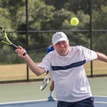 Dr. Craig Miller plays tennis at Harper Creek tennis courts with a regular group on Friday evenings.