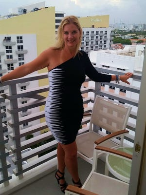 Kelly Warner of Saginaw on the balcony of her hotel in Miami on vacation. Her mother gave her the trip for her 40th birthday.