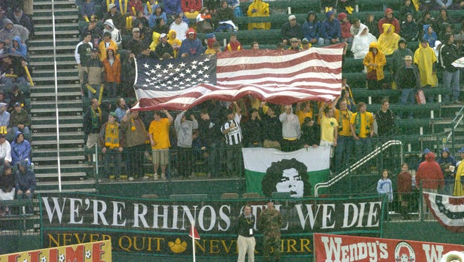 Fans wave a flag during the inaugural match at Rochester's soccer stadium on June 3, 2006. Next week, Rochester resident David Dworkin, a part owner of the Sacramento Kings NBA team, is expected to be named the Rhinos' new owner and run the stadium.