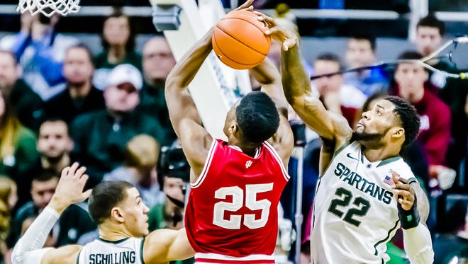 MSU's Branden Dawson blocks a shot attempt by Emmitt Holt during the second half of MSU's 70-50 win over Indiana on Monday night.