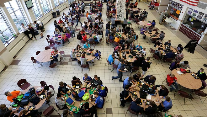 Students eat lunch in the Horace Mann High School lunch room. A total of 54 percent of students in North Fond du Lac are identified as economically disadvantaged.