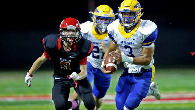 Newport Central Catholic RB Jacob Smith (3) runs past Newport SS Andrew Siebler (5) for a huge gain.
