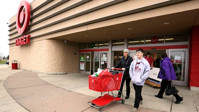 Samantha and Abe Flood of Fond du Lac exit Target on Black Friday. Target was open from 6 p.m. Thursday until 11 p.m. Friday.