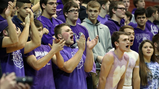 Glen Este's student section cheers on the team.