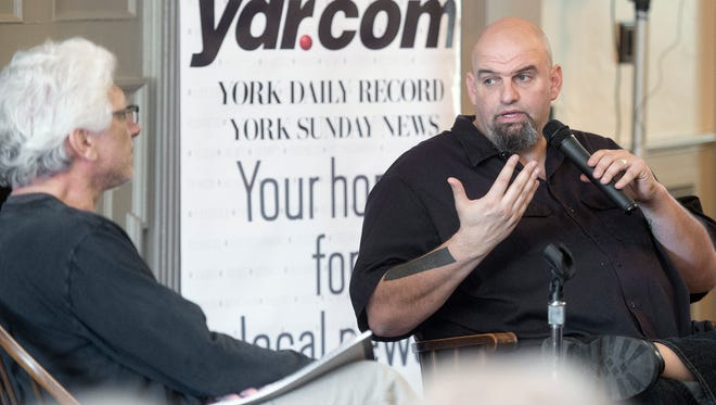 York Daily Record columnist Mike Argento, left, interviews Braddock Mayor John Fetterman.