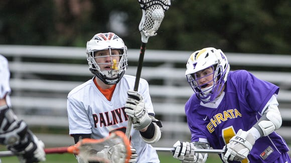 Palmyra'sGrant Haus works his way past Ephrata's Corbin Weaver as Palmyra defeated Ephrata 13-4 on Monday, April 4, 2016.