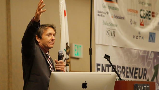 Mark Schniepp, director of the California Economic Forecast, talks about the economic outlook for Ventura and Los Angeles counties during Thursday's conference.