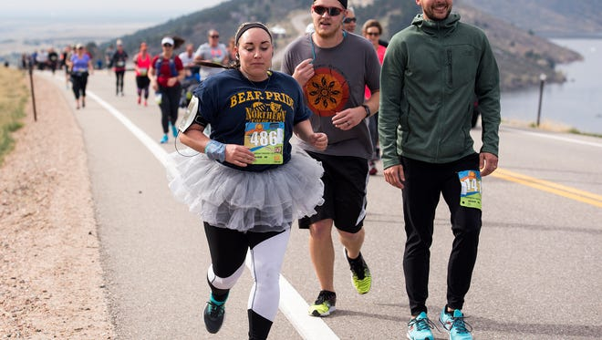 Janay Hill (486) moves past slower traffic on Centennial Drive along Horsetooth Reservoir during the Horsetooth Half Marathon Saturday morning April 23, 2017 in Fort Collins. (Michael Brian/For the Coloradoan)