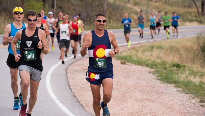 Runners compete in the Colorado Marathon Sunday morning May 7, 2017 along the Poudre River on Colorado State Highway 14. (Michael Brian/For the Coloradoan)