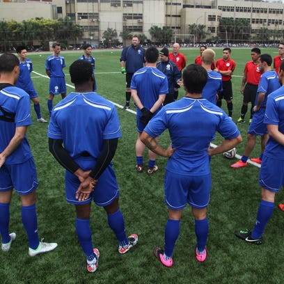 In this file photo, Matao head coach Gary White addresses the team before its training session during a training camp in Chinese Taipei.