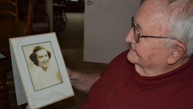 Jim Kleinhans holds a photo of his late wife, Evelyn. It was the care Stein Hospice gave to Evelyn when she was terminally ill that inspired Kleinhans to volunteer for the organization after Evelyn's death.