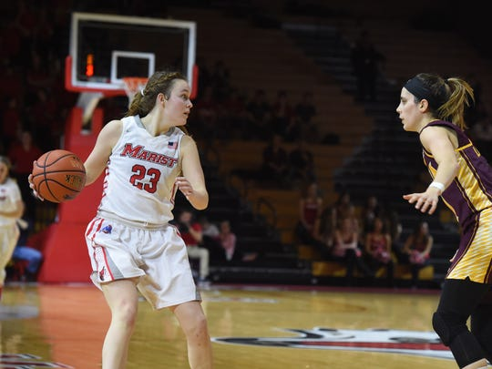 Marist's Rebekah Hand looks for an open teammate during