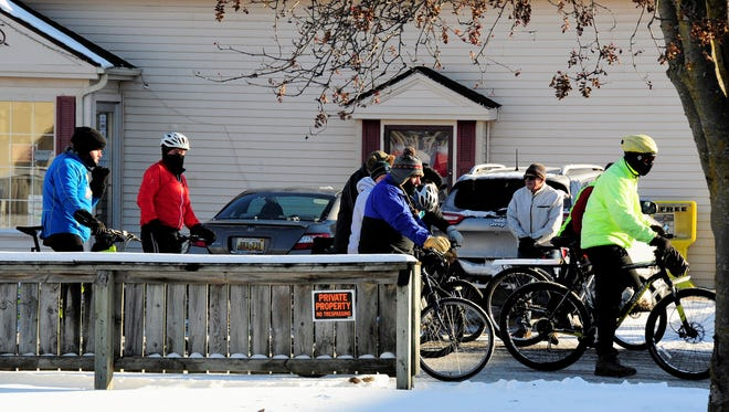 Cyclists prepare to take off for the annual New Year's Day bike ride from Lexington to Croswell on Jan. 1, 2018, in Lexington, Michigan.