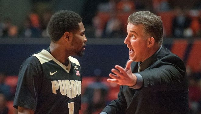 Purdue coach Matt Painter talks to guard Johnny Hill during the second half of an NCAA college basketball game in Champaign, Ill., on Sunday Jan. 10, 2016. Illinois won 84-70.